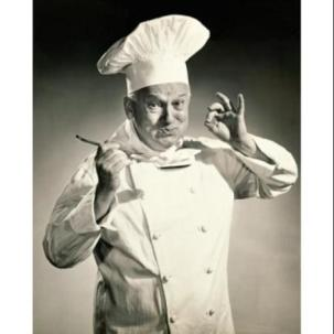 portrait-of-a-chef-tasting-the-food-with-a-spoon-poster-print-18-x-24_1325810
